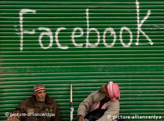 epa02567628 Egyptian protesters sit outside a window shop with the word 'facebook' marked on it as demonstrators are still gathered in a protest called 'Sunday of the martyrs', Tahrir Square, Cairo, Egypt, 06 February 2011. Anti-government protests entered its 13th straight day in Egypt, as solutions were being mulled to bring about a power shift to end the country's political paralysis. Thousands of protesters slept in Cairo's central Tahrir Square, camping out in tents and defying a curfew, while many others streamed to the area in the morning, refusing to relent on their core demand that President Hosni Mubarak step down. EPA/FELIPE TRUEBA