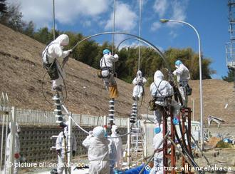 Workers wearing protective gear at the Fukushima nuclear complex