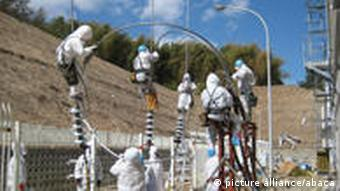 Hand out photo of grid line connection work to offsite power grid (Okuma line) at Fukushima Daiichi Nuclear Power Station pictured on March 18, 2011, Okumamachi, Japan. Plutonium has been found in soil at various points within Japan's stricken Fukushima Daiichi nuclear complex but does not present a risk to human health, operator Tokyo Electric Power Co (TEPCO) said on Monday. Skip related content TEPCO vice-president Sakae Muto told journalists at the company's latest briefing that test results showing the plutonium came from samples taken a week ago. It was the latest bad news from the plant, where evidence of radiation has been mounting and engineers face a protracted battle to control reactors damaged by an earthquake and tsunami on March 11. Photo via ABACAPRESS.COM