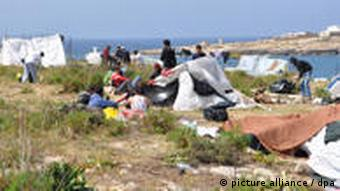 Migrants on Lampedusa, living in tents
