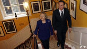 Britain's Prime Minister David Cameron walks with U.S. Secretary of State Hillary Clinton inside 10 Downing Street, in London, Tuesday March 29, 2011. More than 40 governments and international bodies gathered in London to plan for a Libya without Muammar Gaddafi, with Italy and Britain suggesting he might be allowed to go into exile.(AP Photo/Suzanne Plunkett, pool)