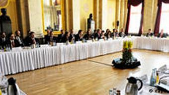 Participants at the conference sitting at a long table