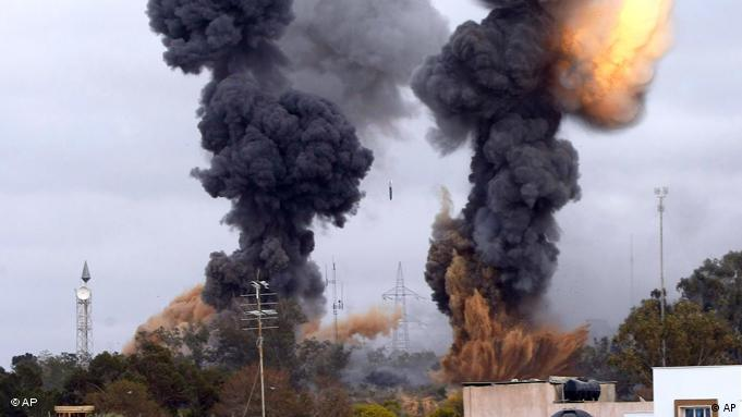 In this photo released by China's Xinhua news agency, heavy smoke rises over the Tajoura area, some 30 km east of Tripoli, Libya, after an airstrike on Tuesday March 29, 2011. (Xinhua/Hamza Turkia) NO SALES