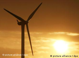The sun dawns on a wind turbine