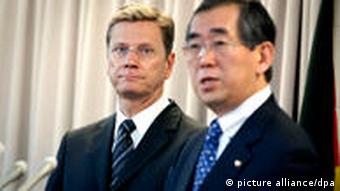 German Foreign Minister Guido Westerwelle in Tokyo with his Japanese counterpart, Takeaki Matsumoto