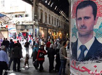 Bashar al-Assad poster in public square
