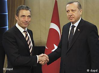 Secretary General of NATO Anders Fogh Rasmussen, left, is welcomed by Turkey's Prime Minister Recep Tayyip Erdogan in Ankara, Turkey, Monday, April 4, 2011. NATO Secretary-General Fogh Rasmussen holds talks with Erdogan and Foreign Minister Ahmet Davutoglu and other government officials after NATO took sole control of air military operations over Libya. The U.S. military will pull its warplanes from front-line missions Monday and shift to a support role in Libyan operations, a NATO official said. (AP Photo/Umit Bektas, Pool)