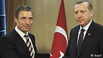 Secretary General of NATO Anders Fogh Rasmussen, left, is welcomed by Turkey's Prime Minister Recep Tayyip Erdogan in Ankara, Turkey, Monday, April 4, 2011.