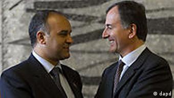 Libyan National Transitional Council's Foreign Minister Ali al-Essawi and Frattini
