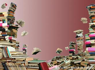 Books stacked up and falling through the air