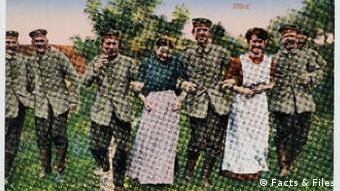Soldiers link arms with young girls in a field
