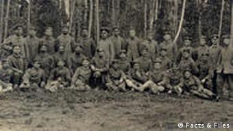 A large group of soldiers in uniform in a forest