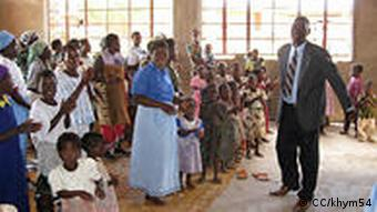 A congregation in Malawi http://www.flickr.com/photos/khym54/3482395187/sizes/z/in/photostream/ License: http://creativecommons.org/licenses/by-nc-nd/2.0/