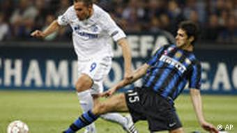 Schalke Brazilian forward Edu, left, is tackled by Inter Milan defender Andrea Ranocchia during a Champions League, first leg, quarterfinal soccer match, at the San Siro stadium in Milan, Italy, Tuesday, April 5, 2011.