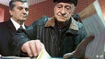 An Sarajevan casting his ballot at a polling station