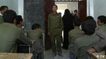 Mohammed address his classmates from the front of their classroom
