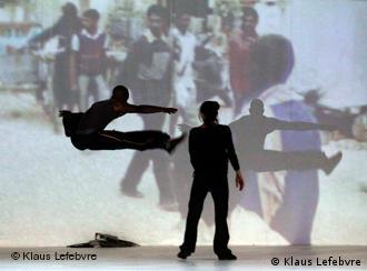 Dancers jumping in front of a video projection