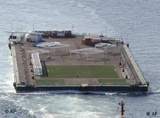 A floating pontoon as a public fishing park is towed off a port in Shimizu, central Japan, Tuesday, April 5, 2011. Shimizu city authority offered the pontoon, known as Mega Float, to Tokyo Electric Power Co.,(TEPCO) to help store highly contaminated stagnant water at the compound of the Fukushima Dai-Ichi nuclear power plant which was damaged by the March 11 earthquake-triggered tsunami. (AP Photo/Yomiuri Shimbun, Masamine Kawaguchi Nagao) JAPAN OUT, MANDATORY CREDIT