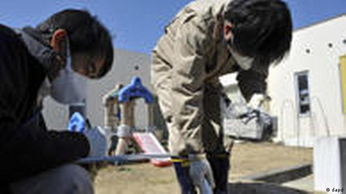 Government employees monitor radiation at day-care center in Iitate, Fukushima prefecture. Photo credit: AP Photo / Yomiuri Shimbun, Kanji Tada, Japan Out.