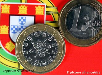 Euro coins over Portuguese flag