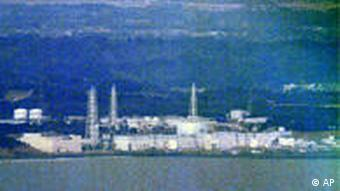 The Fukushima Dai-ichi nuclear power plant is seen in Okuma town, Fukushima Prefecture, northeastern Japan, Thursday, April 7, 2011. After notching a rare victory by stopping highly radioactive water from flowing into the Pacific, workers at the flooded nuclear power complex turned to their next task Thursday: injecting nitrogen to prevent more hydrogen explosions. Nuclear officials said Wednesday there was no immediate threat of explosions like the three that rocked the Fukushima Dai-ichi plant not long after a massive tsunami hit on March 11, but their plans are a reminder of how much work remains to stabilize the complex. (AP Photo/Kyodo News) JAPAN OUT, MANDATORY CREDIT, NO LICENSING IN CHINA, HONG KONG, JAPAN, SOUTH KOREA AND FRANCE