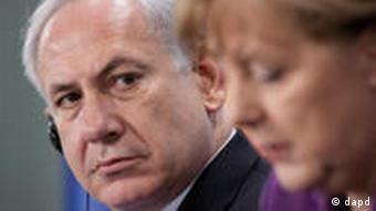 Israeli Prime Minister Benjamin Netanyahu looking at Merkel during the press conference