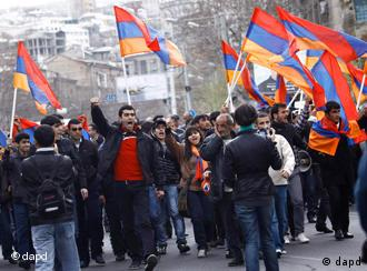 Armenian Opposition supporters carry Armenian flags during an anti-government rally in the Armenian capital