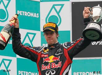 Red Bull Formula One driver Sebastian Vettel of Germany celebrates on the podium after winning the Malaysian Formula One Grand Prix