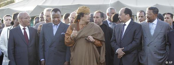 From left : South African President Jacob Zuma, Congo's President Denis Sassou-Nguesso, Libyan leader Moammar Gadhafi, Mauritania President Mohamed Ould Abdel Aziz and African-Union Commissioner John Bing stand outside a tent in Tripoli, Libya, Sunday, April 10, 2011. Envoys from the African Union, including South African president Jacob Zuma , are to hold talks with Gadhafi and rebels during a two-day visit beginning Sunday, as the African Union made a new call for a ceasefire between Colonel Gadhafi's forces and Libyan rebels. (AP Photo/Pier Paolo Cito)