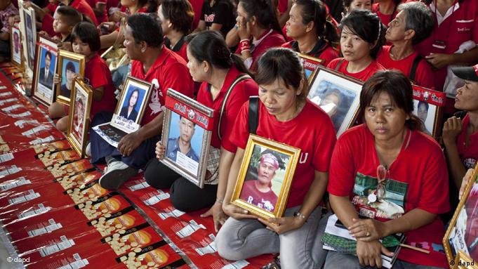 Mourners gather in Bangkok marking the first anniversary of a military crackdown against Red Shirt demonstrators