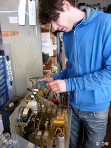 Ole Kretschmann repairs a photo-booth