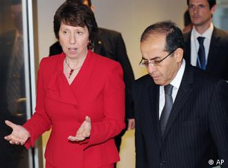 European Union foreign policy chief Catherine Ashton, left, gestures as she talks with Libyan Transitional National Council Member Mahmoud Jibril during an EU Foreign Ministers council in Luxembourg, Tuesday April 12, 2011. (AP Photo/Geert Vanden Wijngaert)