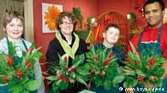Boys and a florist holding flowers