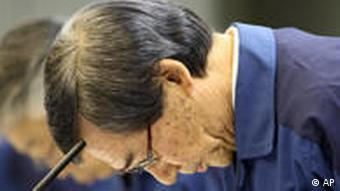 Tokyo Electric Power Co. President Masataka Shimizu bows prior to a press conference at its headquarters office in central Tokyo, Wednesday, April 13, 2011. Shimizu and other company executives bowed in apology on Wednesday as Shimizu pledged to do more to help compensate residents unable to return home or work due to the accident. (AP Photo/Koji Sasahara)
