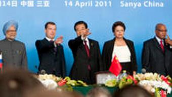 From left to right: Indian Prime Minister Manmohan Singh, Russian President Dmitry Medvedev, Chinese President Hu Jintao, Brazilian President Dilma Rousseff and South African President Jacob Zuma arrive for a joint news conference in Sanya, China Thursday, April 14, 2011. (AP Photo/Nelson Ching, Pool)