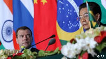 Russian President Dmitry Medvedev, left, looks at Chinese President Hu Jintao at a joint press conference during the BRICS Summit in Sanya, Hainan province, China, on Thursday April 14, 2011. (AP Photo/How Hwee Young, Pool)