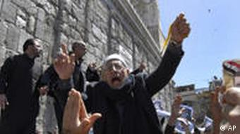 A Syrian pro-government protester shouts slogans during a protest following Friday prayers