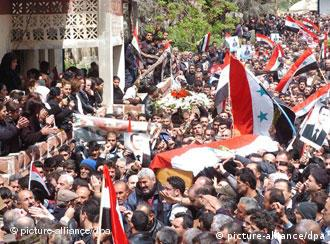 Thousands of mourners at a funeral in Syria