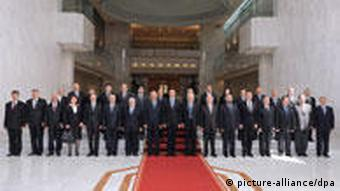 Prexsident Assad with his new cabinet in Damascus