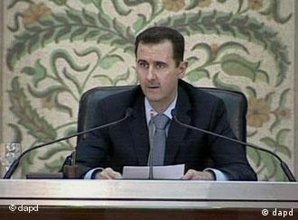 President Bashar Assad making a speech in front of his cabinet in Damasus