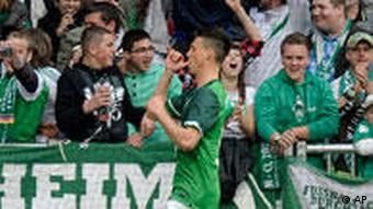 Bremen's Sandro Wagner celebrates his goal during the German first division Bundesliga soccer match between Werder Bremen and FC Schalke 04 in Bremen, Germany, Saturday, April 16, 2011.