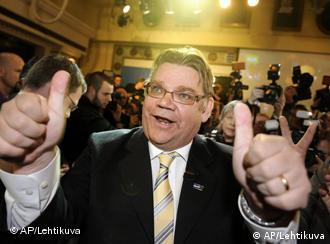 Chairman Timo Soini of the True Finns celebrates with supporters after hearing the results of first preliminary votes of Finnish parliamentary elections at party's reception in Helsinki, Finland on Sunday April 17, 2011. Finns went to the polls in parliamentary elections on Sunday, with early results showing the conservatives in the lead and big gains for the nationalist party that wants to block bailouts for Portugal and other cash-strapped eurozone members. (AP Photo/ LEHTIKUVA / Martti Kainulainen FINLAND OUT. NO SALES