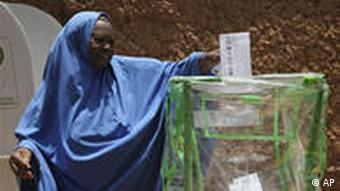 A woman casts her vote at a polling place in Daura, Nigeria, Saturday, April 16, 2011. Voters in Africa''s most populous nation are deciding Saturday whether to keep their accidental president in power, though unease in the country's Muslim north could force a runoff .(AP Photo/Sunday Alamba)