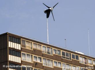 A small wind turbine on a building's roof