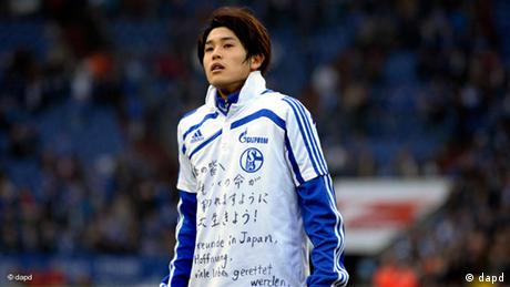 Schalke defender Atsuto Uchida wears a special jersey with well wishes for his countryman caught in the March, 2011 earthquake and tsunami that hit the northeast of the country. (12.03.2011) (Photo: Sascha Schuermann/dapd)