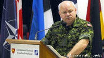 epa02663230 Canadian Lieutenant General Charles Bouchard during a press conference at NATO's Bagnoli base in Naples Italy, on 31 March 2011. On his first day as commander of the Libyan mission, Charles Bouchard said, since NATO assumed control at 0600 GMT on 31 March 2011, its aircraft had conducted more than 90 flights, and the alliance had more than 100 fighter jets and support aircraft at its disposal as well as a dozen frigates to control the Mediterranean. EPA/CIRO FUSCO +++(c) dpa - Bildfunk+++