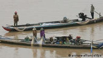 Cambodian fishing boats on the Mekong River in Phnom Penh, Cambodia
