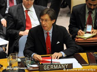 (110318) -- NEW YORK, March 18, 2011 () -- Germany's Ambassador to the UN Peter Wittig speaks after voting on Libyan resolution during an open meeting of the UN Security Council at the UN headquarters in New York, the United States, March 17, 2011. The UN Security Council on Thursday adopted a resolution to authorize a no-fly zone over Libya and called for all necessary measures, excluding troops on the ground, to protect civilians under threat of attack in the North African country. (/Bai Jie)(zyw)