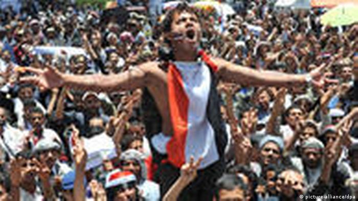 epa02694707 Yemeni anti-government protesters shout slogans during a demonstration demanding the ousting of Yemeni President Ali Abdullah Saleh, in Sana_a, Yemen, 19 April 2011. Clashes erupted between anti-government protesters and police in the southern Yemeni province of Taiz ahead of two meetings expected to discuss unrest in the country. One person was killed and around 20 injured in the clashes. The demonstrators are awaiting the outcome of meetings for the United Nations Security Council and the Foreign ministers of six Gulf countries representing the Gulf Cooperation Council (GCC). Around 100 people are estimated to have been killed since protests began in Yemen mid February, inspired by successful uprising that toppled the longtime rulers in both Tunisia and Egypt. EPA/YAHYA ARHAB