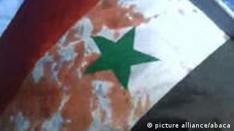 Bloodied flag as people demonstrate against Syrian regime in Baniyas, Syria on April 22, 2011.